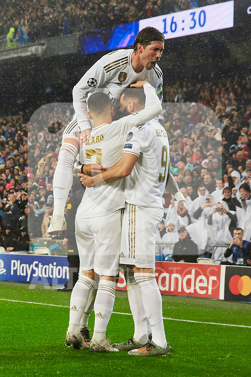Eden Hazard (L), Karim Benzema (R) and Sergio Ramos of Real Madrid celebrate goal during UEFA Champions League match between Real Madrid and Paris Saint-Germain FC at Santiago Bernabeu Stadium in Madrid, Spain. November 26, 2019. (ALTERPHOTOS/A. Perez Meca)