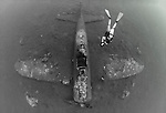 Wreck of a Mitsubishi Zero fighter plane with diver