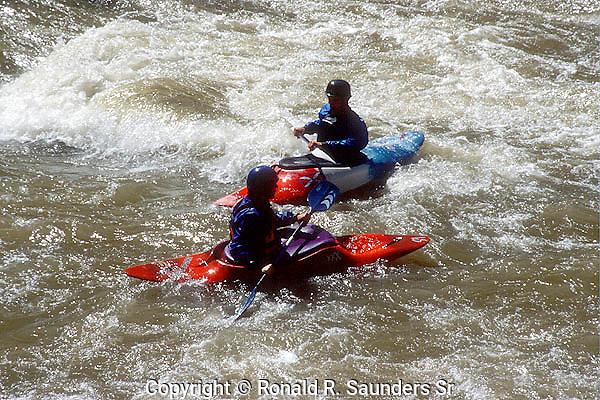 TWO MEN KAYAK IN COLORADO RIVER