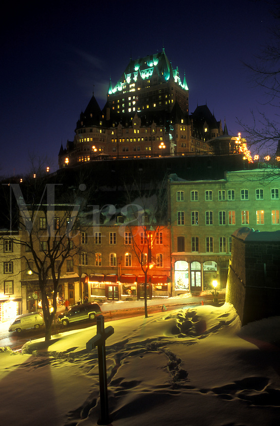 AJ0679, Canada, Quebec, Chateau Frontenac illuminated at night (evening) from Parc Montmorency in winter in Old Quebec City.