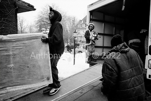 Cleveland, Ohio.March 25, 2008 ..Delivering warning and final eviction notices Detective Robert Kole of the Cuyahoga County Sheriff's Department enters every situation with caution. When the residents are at the home he must assure that all is final and that the home is clear of weapons and that the residents are indeed moving out. ..If no one is there, then he must authorize that the door be forcibly open. He then enters and clears the house at gunpoint in hopes that there are no squatters or inhabitants threaten himself or the movers. He also clears the house for weapons...All emotions and fears are on the surface as some residents greet him by crying on his shoulder while others can threaten him with a weapon...In this intercity Cleveland home the family and friends of Marian Taylor help her move her goods from the home after foreclosing on the loan..