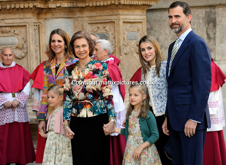 NON EXCLUSIVE PICTURE: MATRIXPICTURES.CO.UK.PLEASE CREDIT ALL USES..UK, AUSTRALIA, NEW ZEALAND AND ASIA RIGHTS ONLY..Spanish royals Queen Sofia, Infanta Elena, Prince Felipe, and his wife Princess Letizia, are pictured attending an Easter service with their daughters Leonor and Sofia, at Palma Cathedral in Majorca, Spain...MARCH 30st 2013..REF: KDA 132131..KM