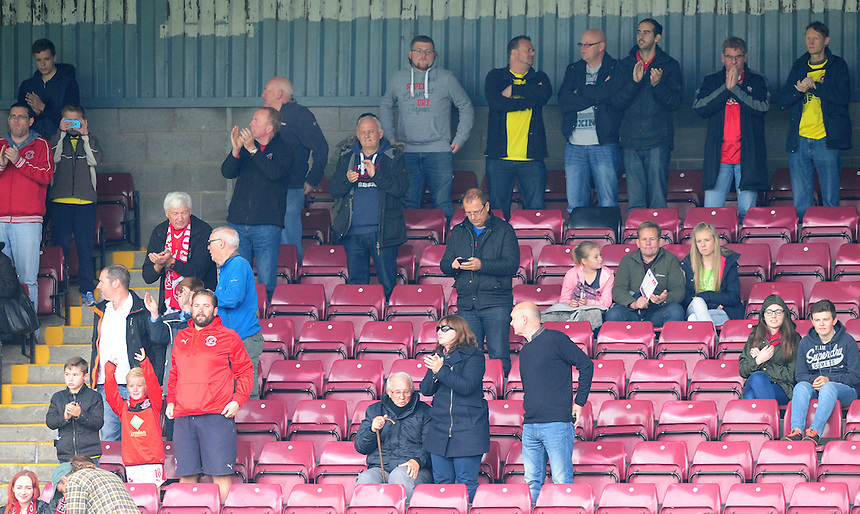 Fleetwood Town fans during the pre-match warm-up <br /> <br /> Photographer Chris Vaughan/CameraSport<br /> <br /> Football - The Football League Sky Bet League One - Scunthorpe United v Fleetwood Town - Saturday 3rd October 2015 - Glanford Park - Scunthorpe<br /> <br /> &copy; CameraSport - 43 Linden Ave. Countesthorpe. Leicester. England. LE8 5PG - Tel: +44 (0) 116 277 4147 - admin@camerasport.com - www.camerasport.com