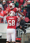 Wisconsin Badgers offensive lineman Ricky Wagner (58) celebrates running back James White (20) touchdown run during an NCAA college football game against the Indiana Hoosiers on November 13, 2010 at Camp Randall Stadium in Madison, Wisconsin. The Badgers won 83-20. (Photo by David Stluka)