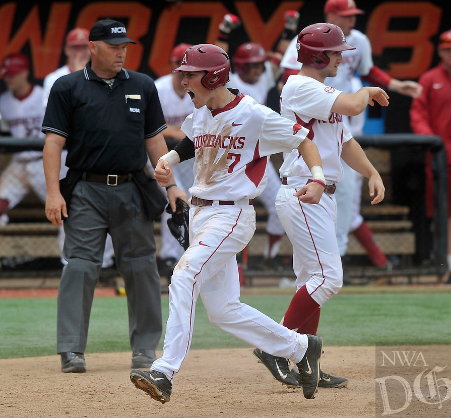 NWA Democrat-Gazette/MICHAEL WOODS --05/29/2015--w@NWAMICHAELW... University of Arkansas baserunner Bobby Wernes (7) scores a run for Arkansas in the 6th inning of Friday afternoons game in the NCAA Regional Baseball tournament against Oral Roberts at Allie P. Reynolds Stadium in Stillwater, Oklahoma.
