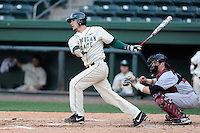 Third baseman Justin Hovis (8) of the Michigan State Spartans bats in a game against the Harvard Crimson on Saturday, March 15, 2014, at Fluor Field at the West End in Greenville, South Carolina. The catcher is Steve Dill (25). Michigan State won, 4-0. (Tom Priddy/Four Seam Images)