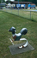 Badger antique cast aluminum spring ride in park near public swimming pool