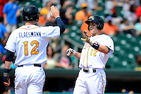 Montgomery Biscuits outfielder Todd Glaesmann #12 greets catcher Mark Thomas #17 at home after Thomas hit a home run during a game against the Mobile BayBears on April 16, 2013 at Riverwalk Stadium in Montgomery, Alabama.  Montgomery defeated Mobile 9-3.  (Mike Janes/Four Seam Images)