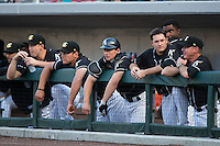 The Charlotte Knights bench watches the action during the game against the Gwinnett Braves at BB&T BallPark on August 11, 2015 in Charlotte, North Carolina.  The Knights defeated the Braves 3-2.  (Brian Westerholt/Four Seam Images)