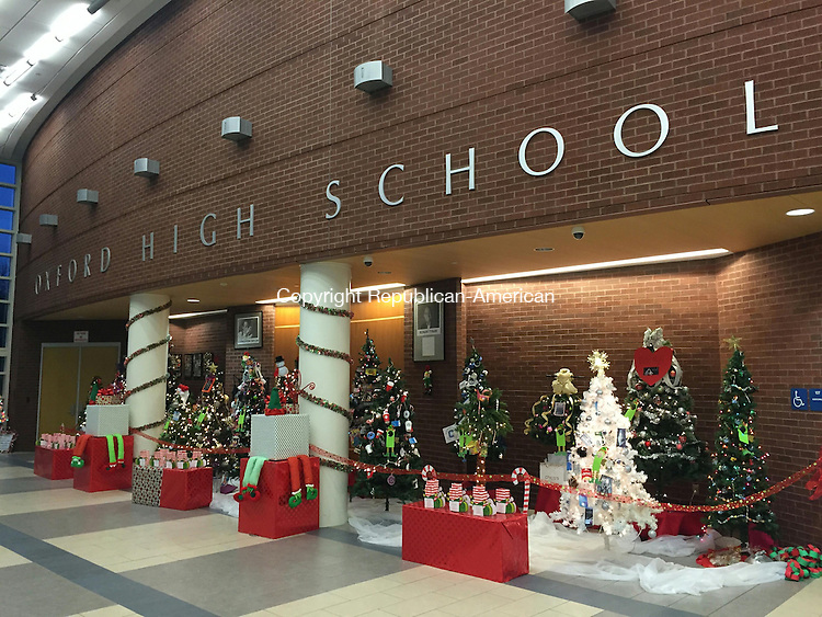 "OXFORD - 09 December 2015 - 120915PS01 - The annual Festival of Trees at Oxford High School, which will be held Friday and Saturday, will raise money for a child to attend the Hole in the Wall Gang Camp for children who are sick. The idea to donate to a child came from Chelsea Wheeler, a 12-year-old Oxford girl who is battling two life-threatening diseases and wanted to ""pay it forward."" Paul Singley Republican-American"