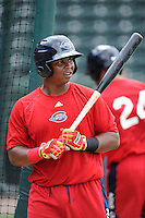 Infielder Rafael Devers (13) of the Greenville Drive works out before a game against the Lexington Legends on Monday, May 18, 2015, at Fluor Field at the West End in Greenville, South Carolina. (Tom Priddy/Four Seam Images)