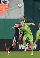 Seattle Sounders forward Nate Jaqua (21) goes up to head the ball against DC United midfielder Andy Najar (left) defender Kitchen Perry (back)    DC United defeated The Seattle Sounders 2-1 at  RFK Stadium, Wednesday May 4, 2011.