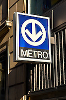 A Montreal metro sign is pictured in downtown Montreal. The Montreal Metro is a rubber-tired metro system and incorporates 68 stations on four lines measuring 65.33 km (40.59 mi) in length.