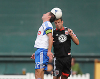 Montreal Impact forward Davy Arnaud (22) heads the ball against D.C. United defender Daniel Woolard (21) D.C. United defeated Montreal Impact 3-0 at RFK Stadium, Saturday June 30, 2012.
