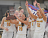 Adelphi University No. 20 Anh-Dao Tran salutes the fans with trophy in hand after she and her teammates defeated American International College 79-57 in the Northeast-10 women's basketball championship at Adelphi's Center for Recreation and Sport on Sunday, March 8, 2015. Tran scored all of her game-high 20 points in the second half as the victory secured the Panthers an automatic bid to the NCAA Division II tournament.<br /> <br /> James Escher