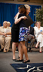 M.O.Campbell Award presenter Brenda Horton hugs Scholarship winner Jasmine Magee at the 2011 Aldine Scholarship Foundation Scholarship Ceremony at Lone Star College - North Harris