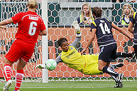 Goalkeeper Karina Leblanc  #1 of the Los Angeles Sol dives to make a save against the Washington Freedom during their inaugural match at Home Depot Center on March 29, 2009 in Carson, California.