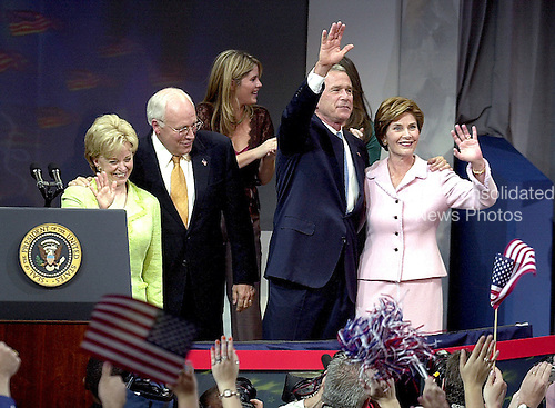 United States President George W. Bush claims victory at the  at the Ronald Reagan International Trade Center in Washington, D.C.  on November 3, 2004.  The President won a second term in a hard-fought campaign against United States Senator John F. Kerry (Democrat of Massachusetts) that attracted a record turn-out of voters..Credit: Ron Sachs / CNP