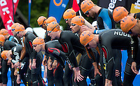 31 MAY 2014 - LONDON, GBR - Alistair Brownlee (GBR) (ENG) (centre left, #15) of Great Britain and England waits on the pontoon for the start of the men's 2014 ITU World Triathlon Series round in Hyde Park, London, Great Britain (PHOTO COPYRIGHT © 2014 NIGEL FARROW, ALL RIGHTS RESERVED)