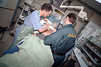 Patient with a suspect heart attack being attended to by doctors nurses and Paramedics in the crash room of an accident and emergency department in hospital. This image may only be used to portray the subject in a positive manner..©shoutpictures.com..john@shoutpictures.com