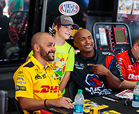 Sep 1, 2018; Clermont, IN, USA; A fan poses for a photo with NHRA drivers J.R. Todd (left) and Antron Brown during qualifying for the US Nationals at Lucas Oil Raceway. Mandatory Credit: Mark J. Rebilas-USA TODAY Sports
