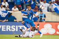 El Salvador midfielder Darwin Ceren (7) crosses the ball as Trinidad and Tobago defender Seon Power (20) attempts to block during a CONCACAF Gold Cup group B match at Red Bull Arena in Harrison, NJ, on July 8, 2013.