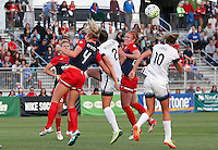 Boyds, MD - Saturday May 07, 2016: Washington Spirit defender Megan Oyster (4) and midfielder Victoria Huster (23) go up for a loose ball with Portland Thorns FC defender Katherine Reynolds (2) and midfielder Allie Long (10) during a regular season National Women's Soccer League (NWSL) match at Maureen Hendricks Field, Maryland SoccerPlex. Washington Spirit tied the Portland Thorns 0-0.