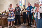August 25, 2017; ND Trail day 12: Core pilgrims present a gift to Katherine Lane following Mass in the Basilica of the Sacred Heart. (Photo by Matt Cashore/University of Notre Dame)