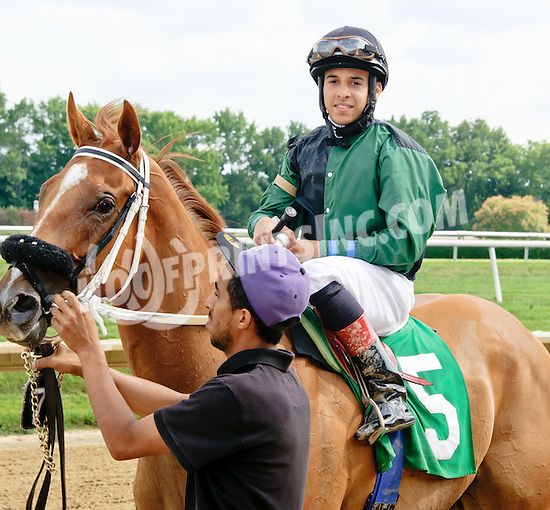 Fray Martinez aboard Silvertonguedtommy after winning at Delaware Park on 7/19/14
