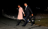 United States President Barack Obama and daughter Sasha walk from Marine One to enter the White House after a trip to Selma, Alabama on March 7, 2015.  <br /> Credit: Dennis Brack / Pool via CNP