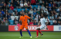 Juninho Bacuna (FC Groningen) of Netherlands & Isaac Buckley-Ricketts (FC Twente (on loan from Manchester City) of England U20 during the International friendly match between England U20 and Netherlands U20 at New Bucks Head, Telford, England on 31 August 2017. Photo by Andy Rowland.