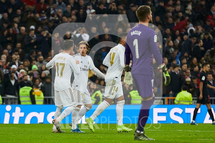 Lucas Vazquez and Luka Modric of Real Madrid celebrate goal during La Liga match between Real Madrid and Sevilla FC at Santiago Bernabeu Stadium in Madrid, Spain. January 18, 2020. (ALTERPHOTOS/A. Perez Meca)