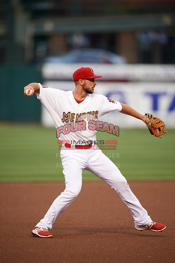 Memphis Redbirds shortstop Paul DeJong (11) warmup throw to first base during a game against the Round Rock Express on April 28, 2017 at AutoZone Park in Memphis, Tennessee.  Memphis defeated Round Rock 9-1.  (Mike Janes/Four Seam Images)