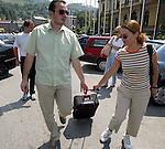 Bosnia and Herzegowina / Sarajevo -09 July 2002--The European Youth Forum tries to bring Balkan youths closer to each other. Renato ZRNIC from Sarajevo (L) helping Donika GODAJ from Albania with her suitcase.--PHOTO: JUHA ROININEN / EUP-IMAGES
