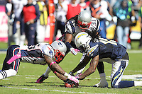 10/24/10 San Diego, CA: New England Patriots safety Brandon Meriweather #3,safety Josh Barrett #36 and San Diego Chargers wide receiver Richard Goodman #15 during an NFL game played at Qualcomm Stadium between the San Diego Chargers and the New England Patriots. The Patriots defeated the Chargers 23-20.