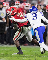 ATHENS, GA - OCTOBER 19: D'Andre Swift #7 of the Georgia Bulldogs spins to evade the tackle of Jordan Griffin #3 of the Kentucky Wildcats and score a touchdown during a game between University of Kentucky Wildcats and University of Georgia Bulldogs at Sanford Stadium on October 19, 2019 in Athens, Georgia.