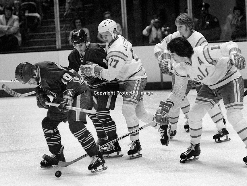 Seals vs Buffalo Sabres, Craig Ramsay, with Seals John Stewart, Jim Neilson, and Stan Weir....(1975 photo/Ron Riesterer)