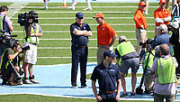 CHAPEL HILL, NC - SEPTEMBER 28: Head coach Mack Brown  of the University of North Carolina talks with head coach Dabo Swinney of Clemson University during a game between Clemson University and University of North Carolina at Kenan Memorial Stadium on September 28, 2019 in Chapel Hill, North Carolina.