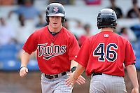 Center fielder Austin Diemer (11) of the Elizabethton Twins is congratulated after scoring a run in a game against the Johnson City Cardinals on Sunday, July 27, 2014, at Howard Johnson Field at Cardinal Park in Johnson City, Tennessee. The game was suspended due to weather in the fifth inning. (Tom Priddy/Four Seam Images)