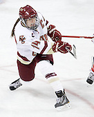 Katelyn Kurth (BC - 14) clears the puck. - The visiting Boston University Terriers defeated the Boston College Eagles 1-0 on Sunday, November 21, 2010, at Conte Forum in Chestnut Hill, Massachusetts.