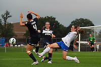 Boston Breakers midfielder Heather O'Reilly (9) goes for the ball with Sky Blue FC midfielder Katy Freels (Frierson) (17) and defender Caitlin Foord (4). Sky Blue FC and the Boston Breakers played to a 0-0 tie during a National Women's Soccer League (NWSL) match at Yurcak Field in Piscataway, NJ, on July 13, 2013.