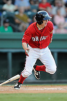 Right fielder Danny Mars (12) of the Greenville Drive bats in a game against the Lexington Legends on Sunday, August 31, 2014, at Fluor Field at the West End in Greenville, South Carolina. Mars is a sixth-round pick of the Boston red Sox in the 2014 First-Year Player Draft out of Chipola College. Greenville won, 3-2. (Tom Priddy/Four Seam Images)