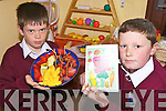 PYRAMID: Darren Quirke and Sean Griffin checking out the food pyramid at the launch of a new recipe book at Glenderry national school in Ballyheigue on Friday.