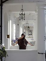 Bita Daryabari stands in the entrance to her London home