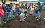 School children prepare garden plots and plant vegetables in San Jose la Frontera, a small Mam-speaking Maya village in Comitancillo, Guatemala. The program is jointly sponsored by the community's school and the Maya Mam Association for Investigation and Development (AMMID). Supervising the activity is Estuardo Aguilon (right), an agricultural specialist with AMMID.
