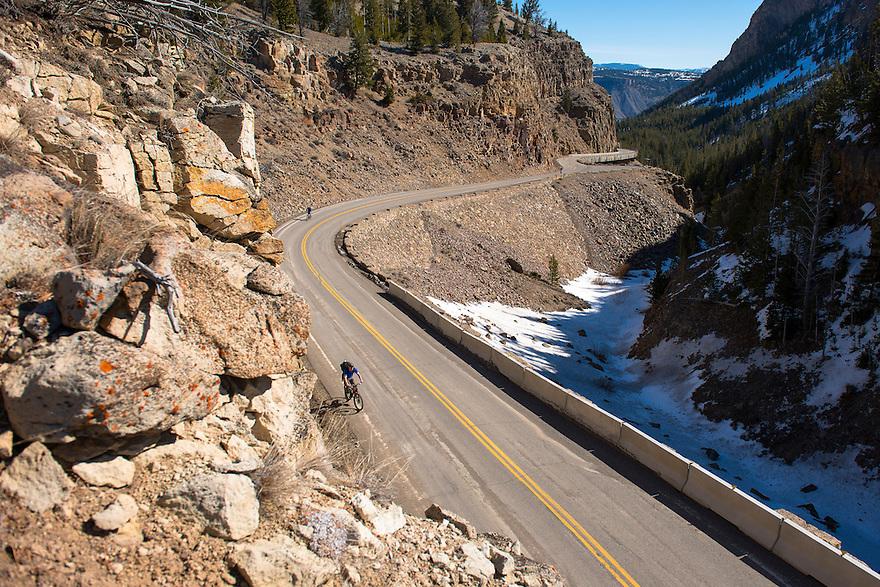 Matt Ludin, of Bozeman, Montana, front, rides through the Golden Gate near Rustic Falls in Yellowstone National Park.