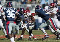 Hawgs Illustrated/BEN GOFF <br /> David Williams, Arkansas running back, evades DeMarquis Gates, Ole Miss linebacker, on a run in the fourth quarter Saturday, Oct. 28, 2017, at Vaught-Hemingway Stadium in Oxford, Miss.