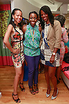 Nana Eyeson-Akiwowo (left), posing with guests during the African Health Now - Fashion Fete event, at the Tracy Reese store on 641 Hudson Street, June 20, 2013.