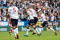 Bolton Wanderers' Mark Beevers, David Wheater, Luke Murphy and Pawel Olkowski celebrate their side's first goal<br /> <br /> Photographer Andrew Kearns/CameraSport<br /> <br /> The EFL Sky Bet Championship - Bolton Wanderers v Bristol City - Saturday August 11th 2018 - University of Bolton Stadium - Bolton<br /> <br /> World Copyright &copy; 2018 CameraSport. All rights reserved. 43 Linden Ave. Countesthorpe. Leicester. England. LE8 5PG - Tel: +44 (0) 116 277 4147 - admin@camerasport.com - www.camerasport.com