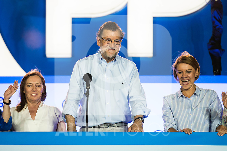 Mariano Rajoy and his wife Elvira Fernandez Balboa (L) and Maria Dolores de Cospedal (R) during the celebration of the victory of the Spanish Elections at the headquarter of Partido Popular in Madrid. June 26, 2016. (ALTERPHOTOS/BorjaB.Hojas)